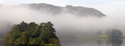 Loughrig Fell appearing above Rydal Water mist